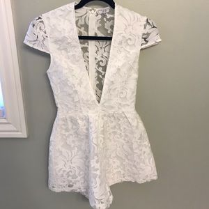 Tobi white lace romper small with deep v cut